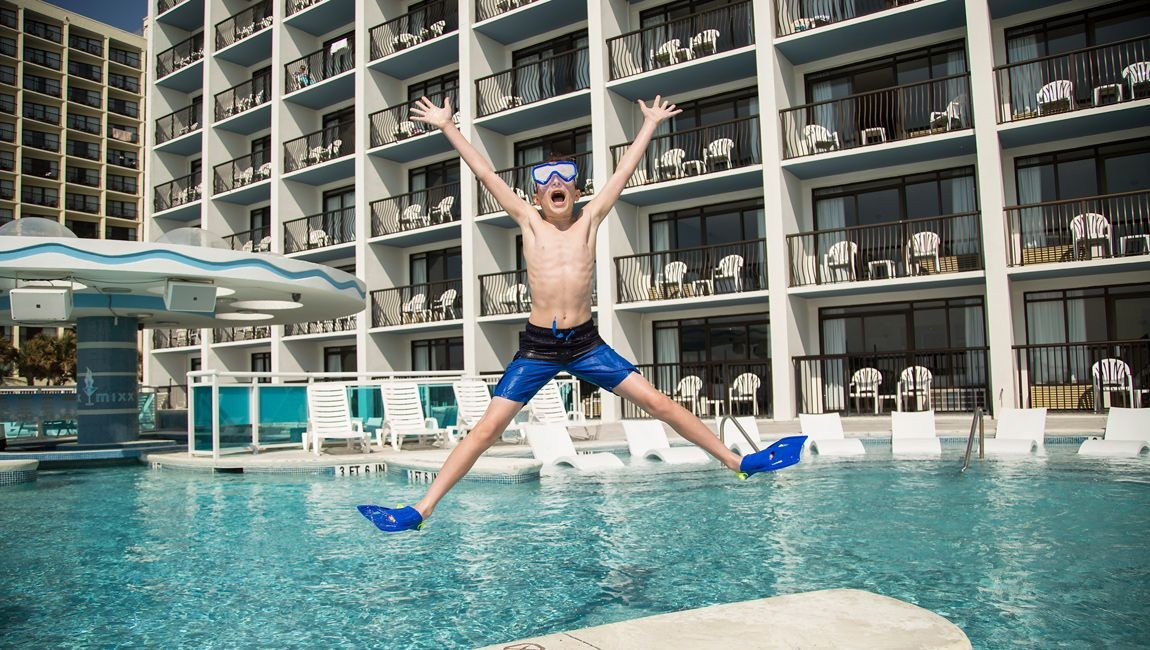 Boy jumping in the pool